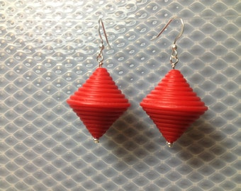 Lantern shaped earrings in red.