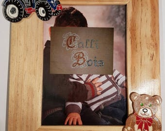 Personalized wooden photo frame with engraved calligraphy, and teddy motif and tractor carvings, all made by hand