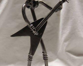 Miniature guitar player novelty figurine.  All metal