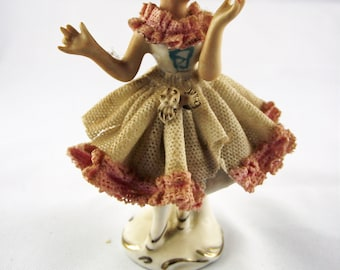 Old porcelain figure, about 7.5 cm high