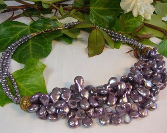 Shimmering purple pearls with sparkling pink quartz and large Byzantine style vermeil beads and hook clasp. Complimentary to every skintone