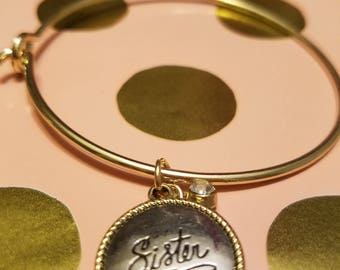 Gold expandable bracelet with silver/gold charm