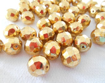 A set of six beads 12 mm gold faceted Czech glass.