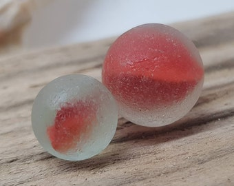 Pair of red sea glass marbles,perfect sea worn condition,genuine surf tumbled scottish sea glass,tiny marble.