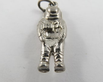A Sterling Silver Charm of an Astronaut in Full Uniform.