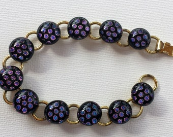 Dichroic glass gold bracelet bright purple, blue and pink on black