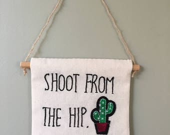 Hand Embroidered Wall Banner - 'Shoot From The Hip'