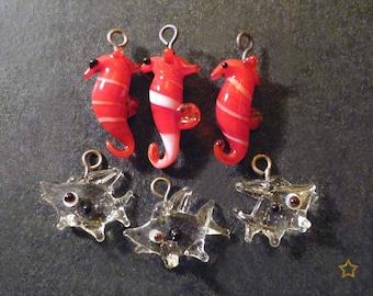 Seahorse and fish looks like glass pendants