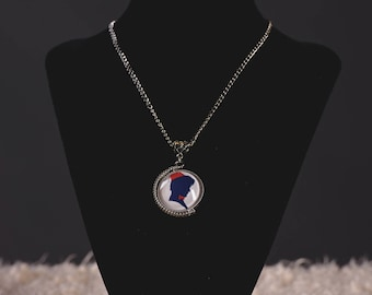 Doctor Who inspired two-sided/spinning 11th Doctor and River Song silhouette image pendant necklace.