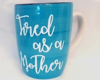 Tired as a Mother 12 oz  blue Coffee mug.