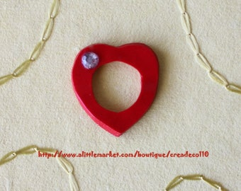 Red heart adorned with a handmade Fimo size 54 made rhinestone ring