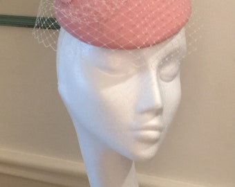 Pink wool felt button hat / fascinator with twirl and veiling