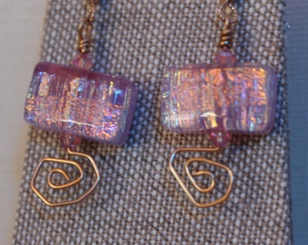 Dichroic glass dangle earrings in pink with fire highlights.