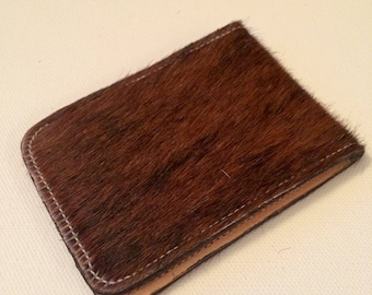 Brown fluffy genuine leather cardholder. Protecting inlayer