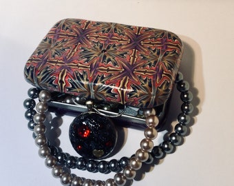 Striking Polymer Clay Cane Covered Tin