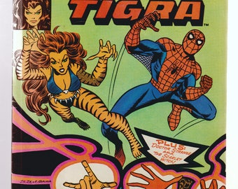 Marvel Team-Up Spider-Man and Tigra comic book in Good to Very Good condition.