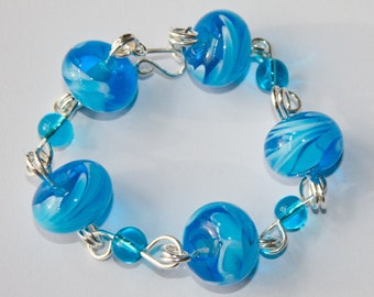 Handmade Silver Plated Bracelet with Swirly Blue & White Lampwork Glass Beads