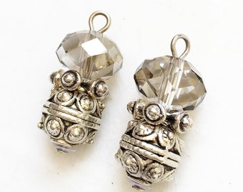 salvaged jewelry components gray transparent glass bead and detailed scrolling design antiqued silver tone metal dangles--matching lot of 2