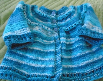 Boy's sweater and toque in size 6 to 9 months approx.