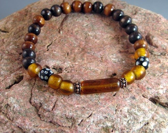 Brown beaded stretch bracelet, mens beaded bracelet, wound glass trade beads, rustic jewelry, tribal jewelry, earth tone colors, southwest