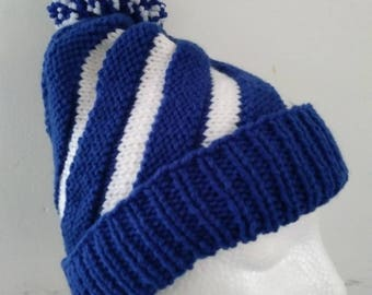 Hand Knitted Children Swirl hat with pompom, fits age 6 to Teen royal blue and white