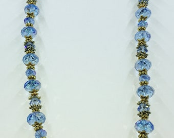 Ursula Necklace: Cornflower blue Swarovski crystals, antique gold color spacer beads.  23.5 inches long