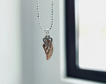 Chain with angel wing pendant
