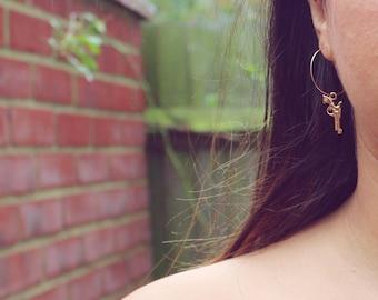 Angelina~gold gun earrings~pistol hoop earring~gold hoop earring~90s earrings~90s hoop earrings~dangly earrings~statement earrings~unique