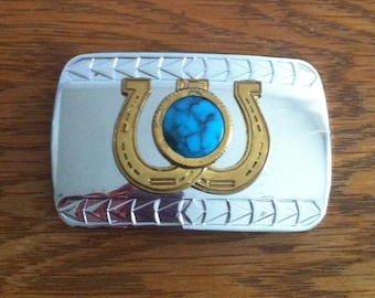 Double Horseshoe buckle with turquoise blue stone in middle