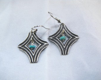 Turquoise, silver, southwest style, dangle earrings with black patina