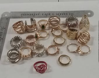 Lot of 22 assorted rings. Assorted sizes may have minor issues and wear.