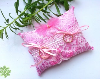 Pink ring-bearer pillow with satin ribbons, laces and beadwork