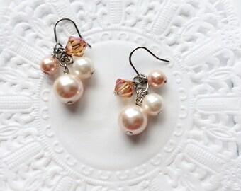 Dainty peach swarovski pearl earrings. Peach wedding bridesmaids gift