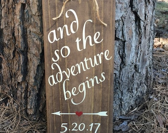 And so the adventure begins wood sign