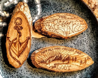 """Three 4"""" and 1/2""""-3"""" and 1/2"""" woodburned magnets"""