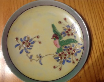 Hand painted ceramic saucer