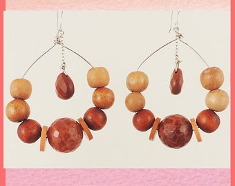 Wooden hoop earrings with an unexpected dangling teardrop