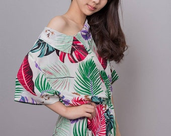 Mid length dress with tropical print
