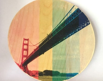 "Rainbow Pride: Sailor's Golden Gate Bridge - 5"" Round Distressed Photo Transfer on Wood"
