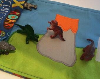 Dinosaur toy carrier roll mat