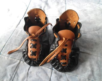 Leather booties for the baby.