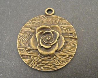 Charm or pendant bronze color flower