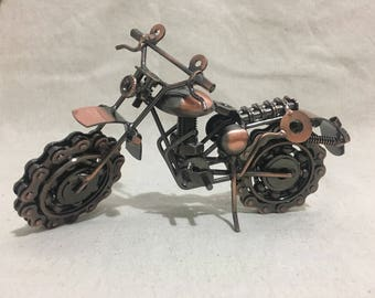 Metal motorcycle sculpture copper paint