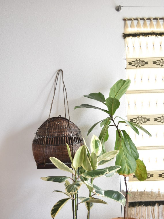 large unique woven rattan storage basket with handles | fisherman's fish holding basket