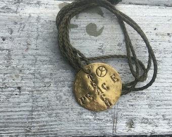 Vintage brass dogtag on paracord necklace vintage brass (teach peace )