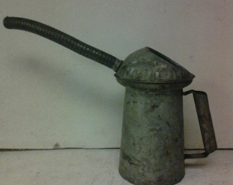 oil measuring can