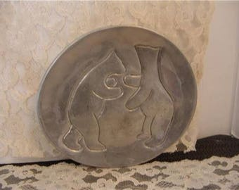 Native art - images of bears inscribed on metal disc
