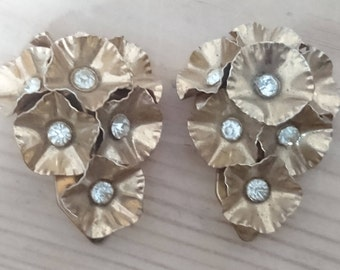 Vintage yellow metal flower and rhinestone pair of dress clips