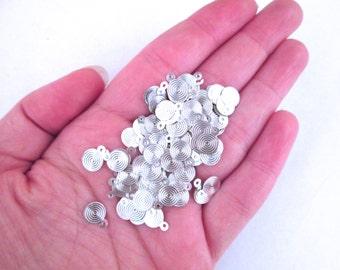100 Plus 7mm Silver Glue On Bails 10x7mm, A54