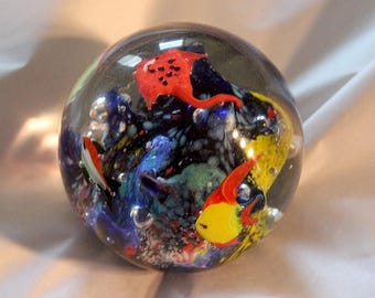 Mult color paperweight with various sea creatures and fish